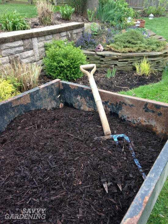 How to mulch garden beds effectively.