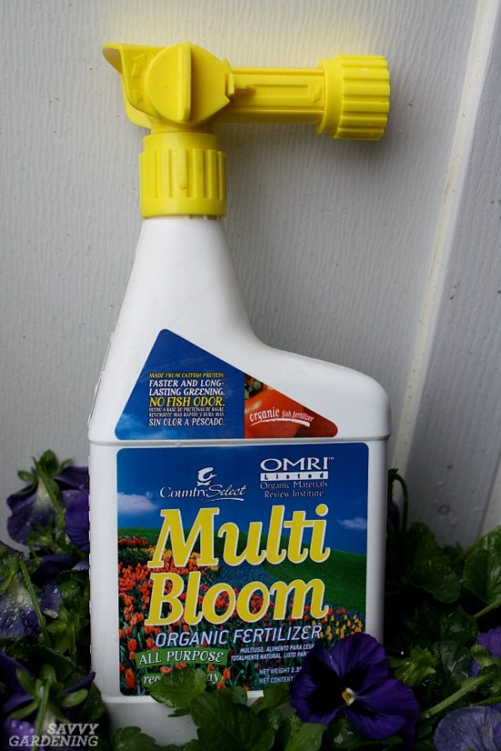 Applying liquid fertilizer to container gardening plants is easy with a hose-end sprayer.