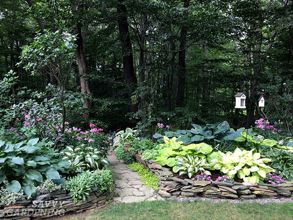 Stacked fieldstone garden border idea