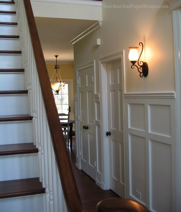 White wainscoting refinished banister and stairs