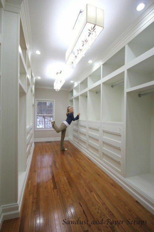 Custom made closets with white built-in cabinets