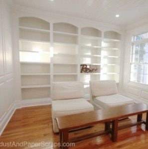 Wall to wall, white, built in bookcases