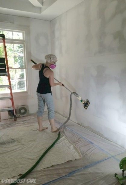 Dust-free drywall sanding - shower cap hair protection.  Hey, it works!