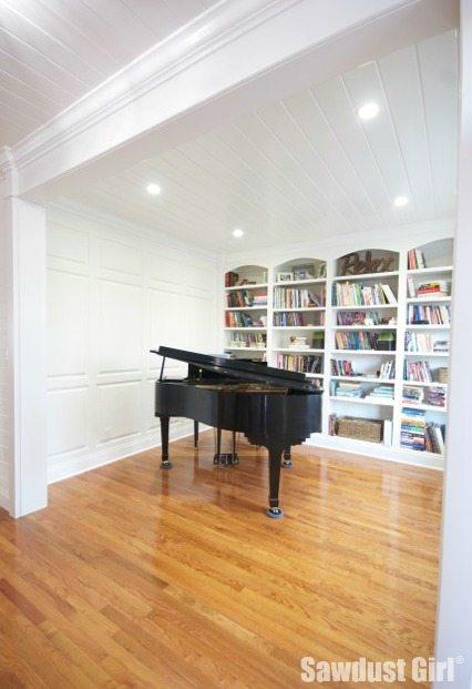 black piano in library