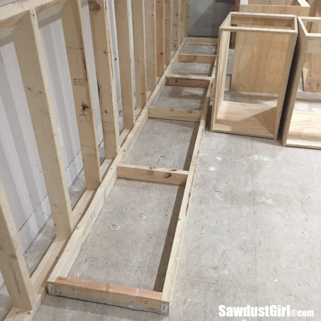Building a base to raise cabinets and create toe-kick space.
