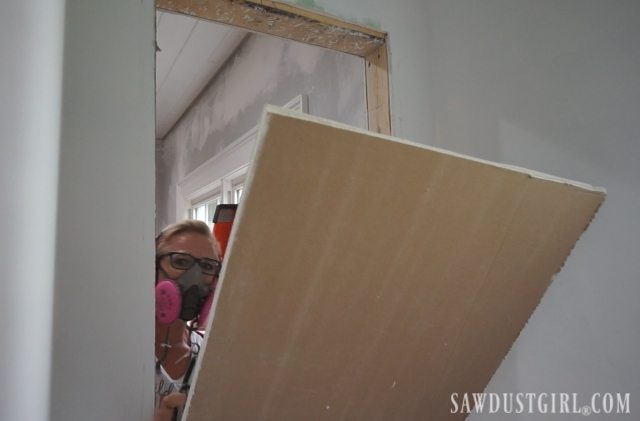 Removing drywall to build a cabinet between studs