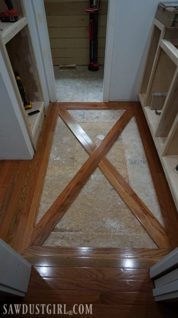 Wood floor with brick tile inlay