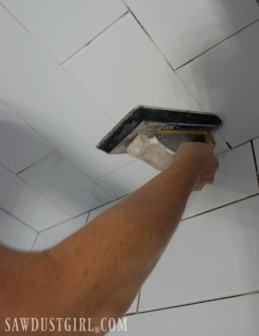 Grouting shower tile