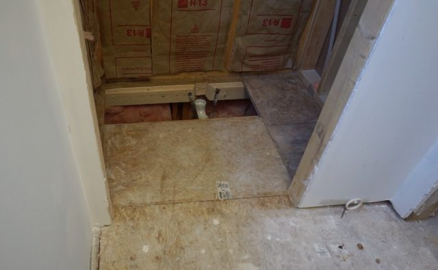 Installing preformed shower pan.