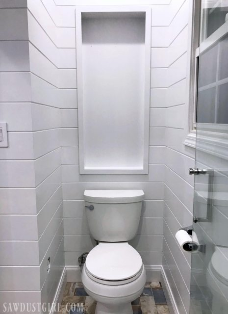 Recessed over the toilet cabinet