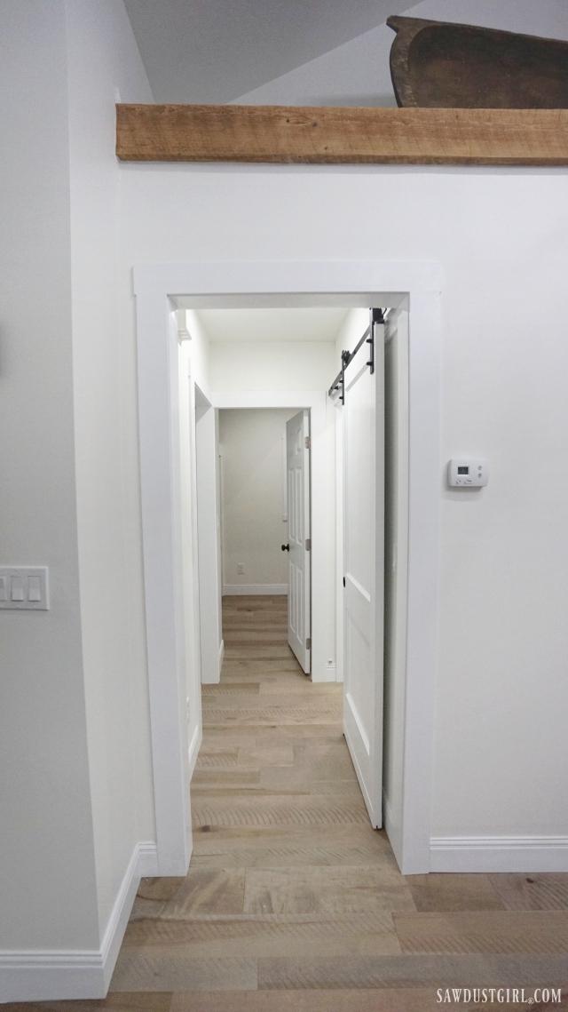 hallway with barn door and exposed beam