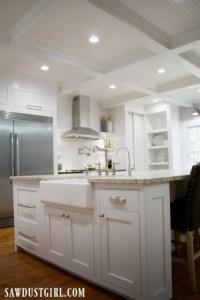 Kitchen with white cabinets and box beam ceiling