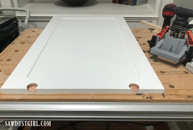 Drilling holes for sliding cabinet door wheels