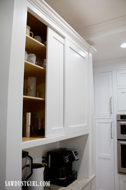 Sliding doors to hide cups and glasses in coffee bar cabinet