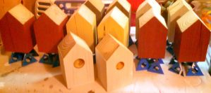 Birdhouses being painted