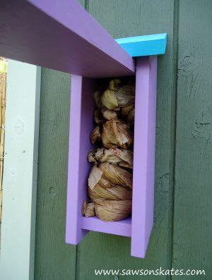 Birdhouse Poop Bag Dispenser load bags
