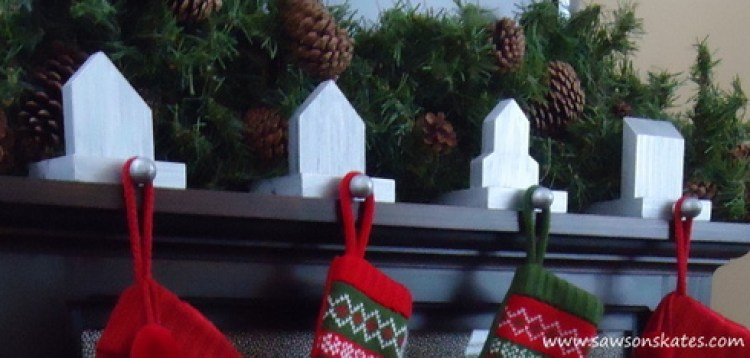 Four DIY stocking holders on a fireplace mantel