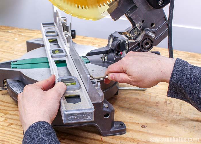 Using a straightedge to square the left fence of the miter saw to the right fence of the miter saw