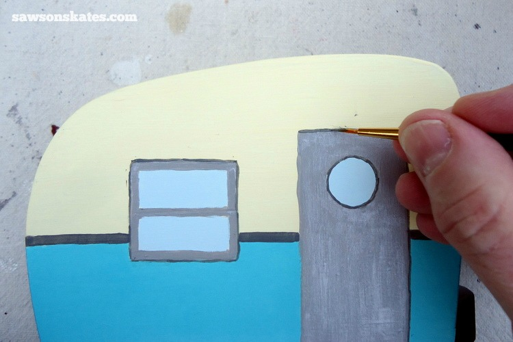 This simple trick will make you look like a freehand painting pro - Use a fine artist brush and a darker color to outline elements on the project. This gives the piece a finished look and makes the elements pop.