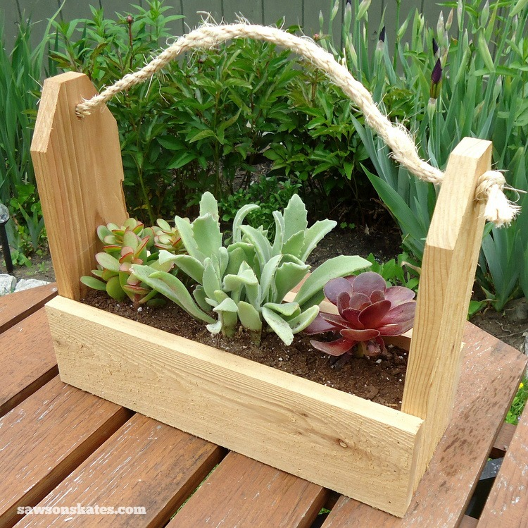 These wooden DIY outdoor planters are practically FREE... they're all made with scrap wood - Rustic Tool Caddy Planter
