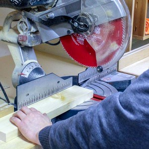 Cutting a piece of wood with a miter saw