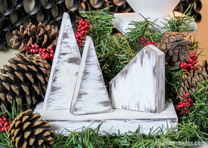 This rustic DIY Christmas Village was made with scrap wood and finished with chalk paint. It's an easy project that only takes about 30 minutes to make.