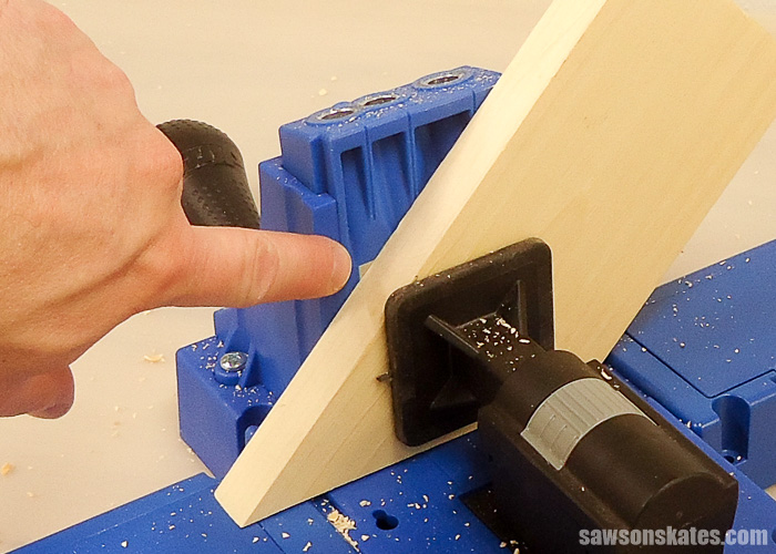 Drilling pocket holes on miter joints - Here's what you want the back of the of the jig to look like. You always want the hole covered. This will ensure the pocket hole will be drilled through the face of the board rather than the edge of the board