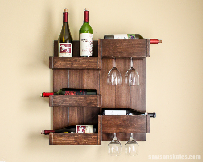 This wall-mounted DIY wine bar is a space-saving alternative to a wine cabinet. It's an attractive display for bottles, glasses, liquor and bar accessories.