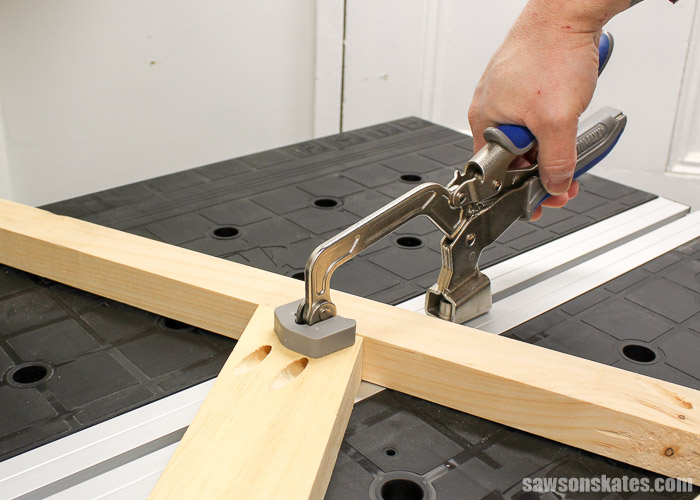 Best Workbench Features - The Mobile Project Center includes a bench clamp that can be mounted to the tabletop using the T-slot.