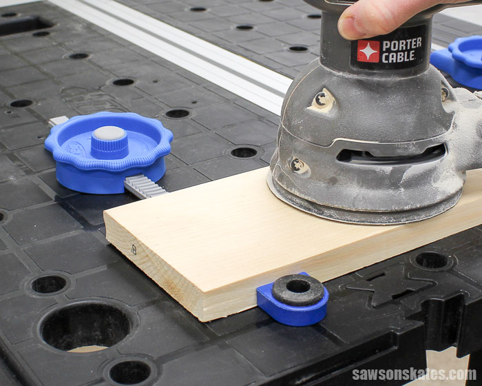 Best Workbench Features - Bench dogs combined with Kreg In-Line Clamps make the Mobile Project Center the best place to sand your DIY project.