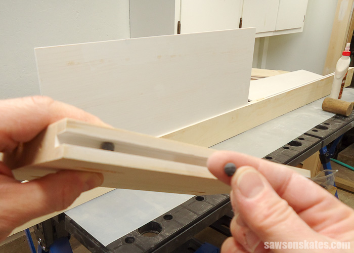 Make a Door with Pocket Holes - spacer balls allow the panel to float in the dado