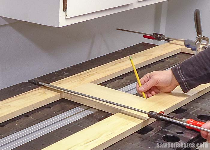 Marking the groove for the DIY door made with pocket holes