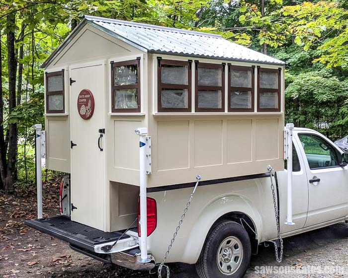 Build a DIY Camper! Use these plans to build a DIY truck camper that looks like a tiny house! It's lightweight and perfect for small pickups!