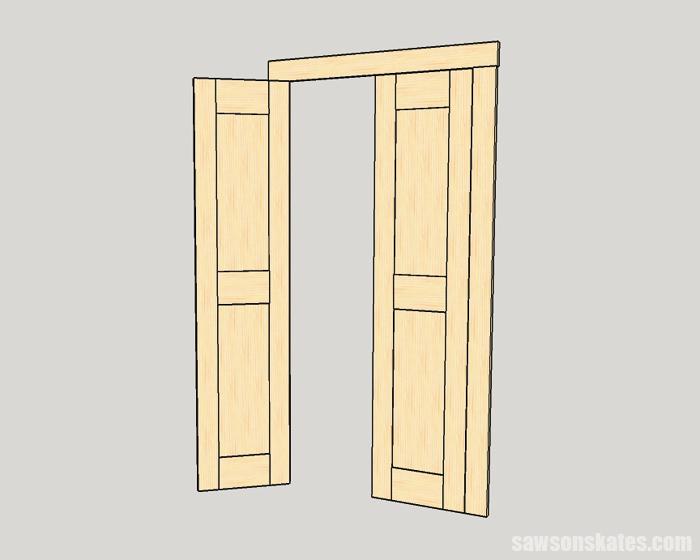 A DIY interior door built with solid wood panels