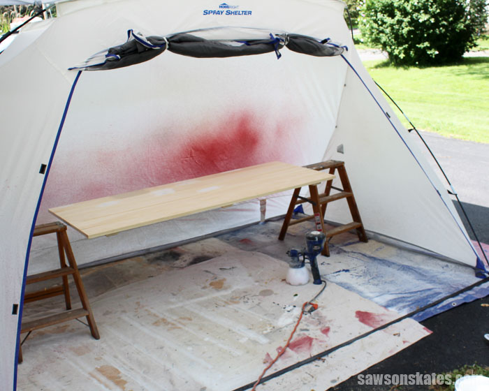 Use a spray shelter when you spray paint doors to protect surrounding objects from overspray