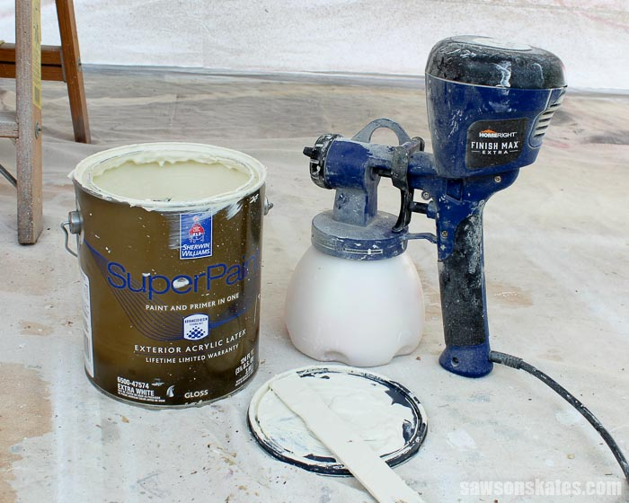 When spray painting doors choose a quality paint then thin to ensure it will properly flow throught the sprayer.
