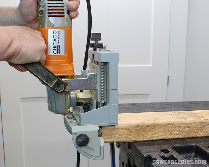 A biscuit joiner cutting a biscuit slot into the face of a workpiece