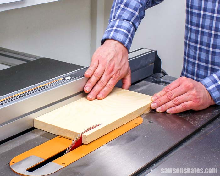 A table saw is a woodworking tool beginners should consider buying when setting up their workshop