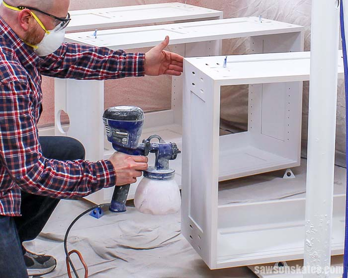 Using a paint sprayer indoors doesn't have to be messy. Use these simple tips to spray paint furniture and DIY projects inside without getting it everywhere!