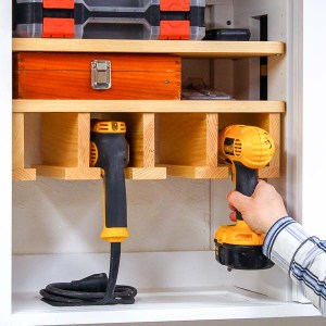 Placing a cordless drill into drill storage rack