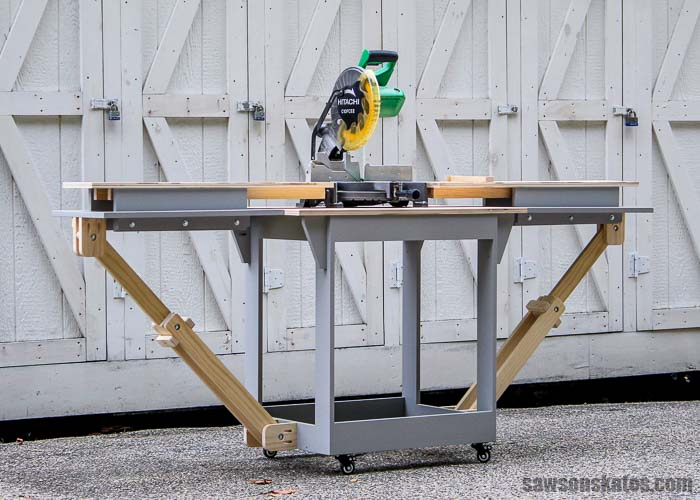 A DIY portable miter saw station with the folding wings extended