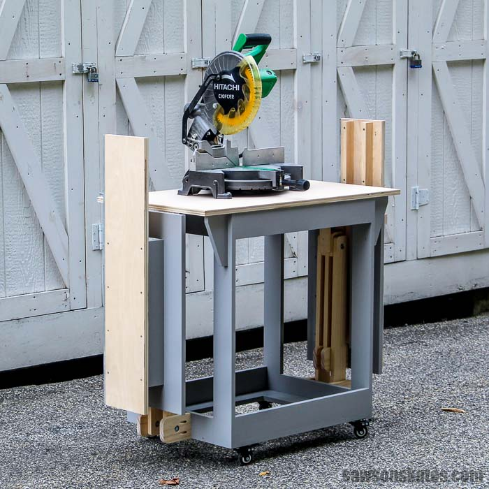 This DIY miter saw station folds to save space and has wheels to make it mobile.