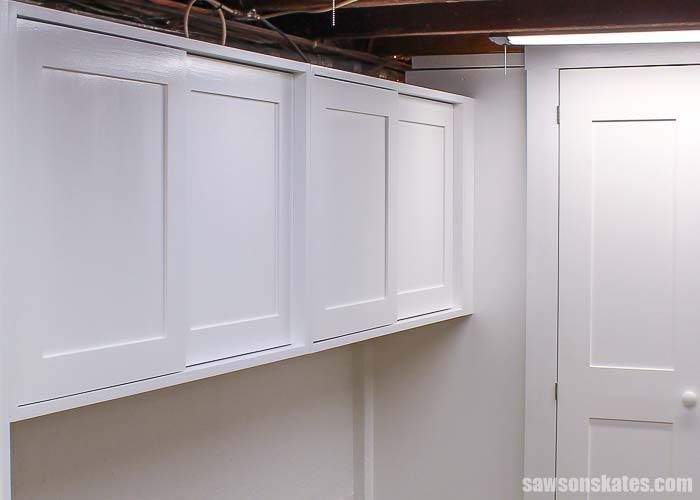 The DIY workshop storage cabinets installed on the wall