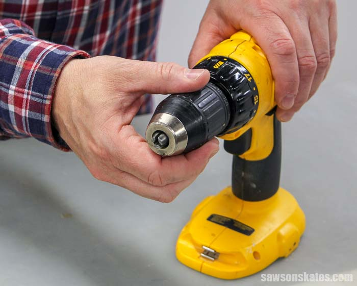 How to put a drill bit in a drill: hold the drill and open the jaws of the chuck