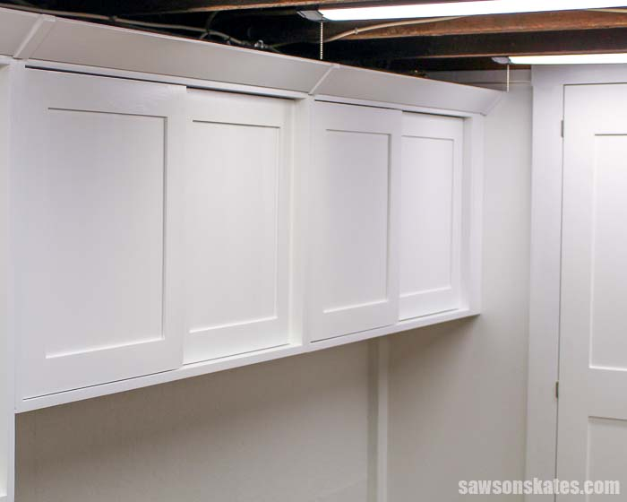 DIY crown molding made with a table saw install on cabinets
