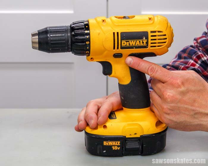 The forward reverse button changes the direction a drills spins and is part of learning how to use a drill