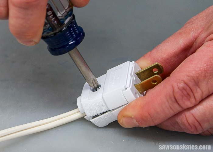 Closing the cover of a replacement plug is the last step to wiring a plug.