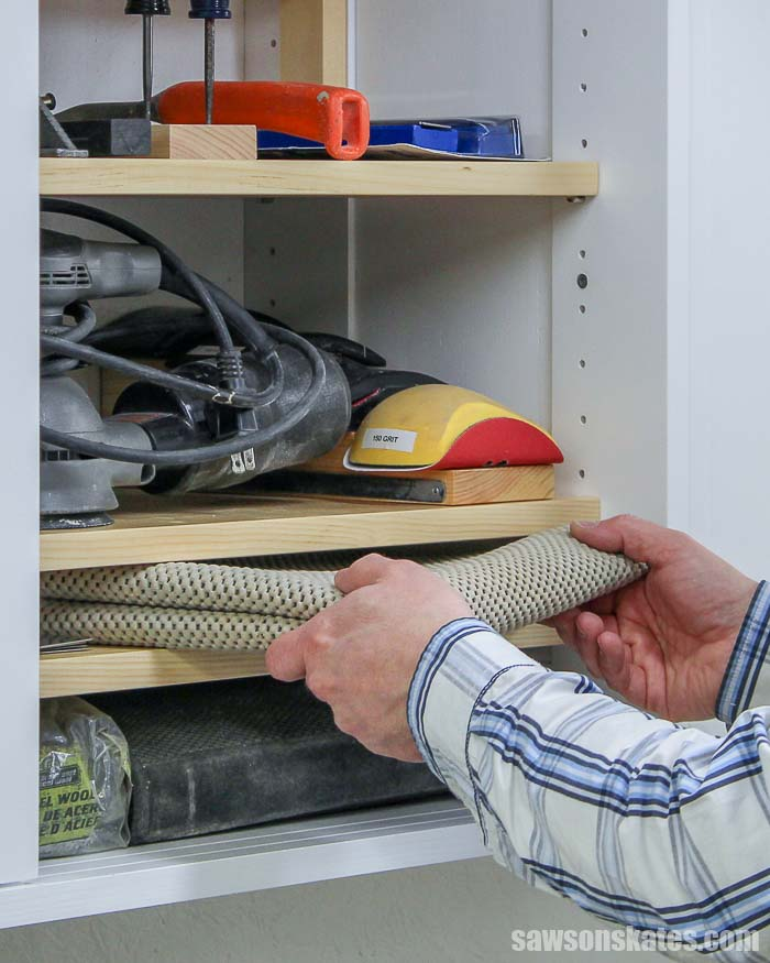 Showing how to organize tools on shelves a small workshop