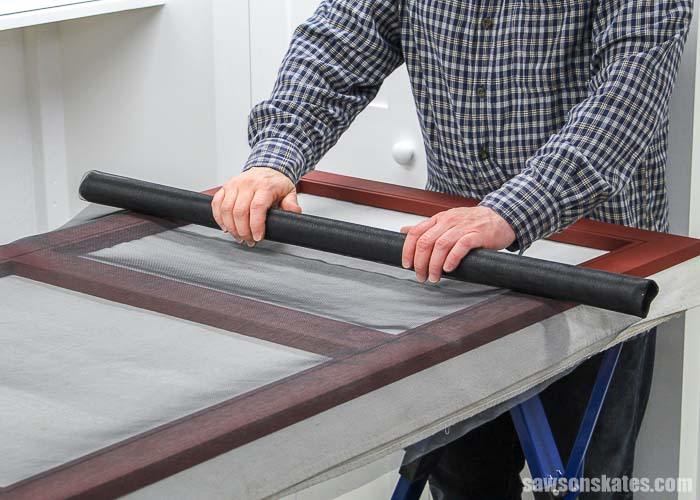 Rolling out window screen to rescreen a window