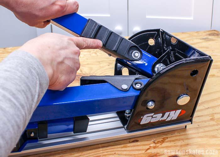 The Kreg Track Horse sawhorse leg-pivot lock allows the legs to fold